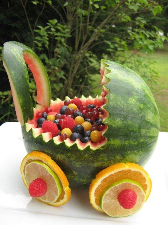 How to make a watermelon baby carriage for twins. Click to see easy to follow video instructions to make your own DIY watermelon carriage. Pin it. #babyshower #babyshowerfood #babyshowerdecorations
