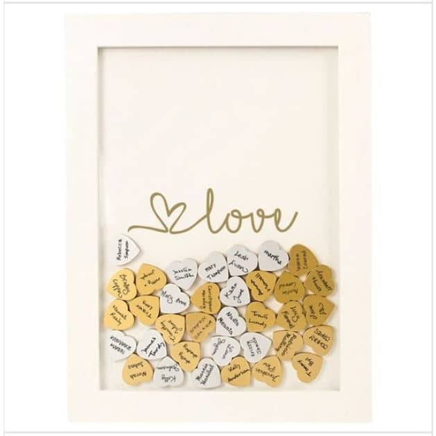 Looking for a great baby shower guest book alternative. Click to see tons of unique ideas that will knock their socks off. Some ideas are easy DIY, some are kind of rustic. Pin it. #babyshower #guestbook
