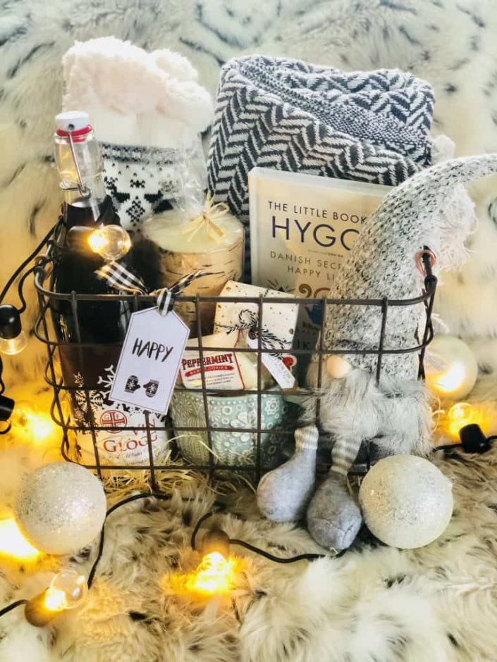 This is a comprehensive list of DIY Christmas gift basket ideas for everyone on your list. The list covers families, mom, couples, men, coworkers, neighbors, kids, baskets for dogs, wine baskets and more. Pin it. #christmas #festive #holidays