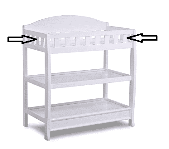 baby changing table with safety barriers