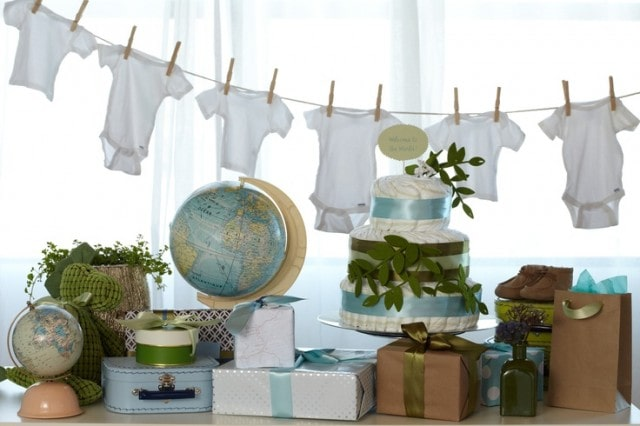 Baby Shower Clothesline Ideas | Hanging onesies is a great idea for baby shower decorations. It's like a DIY banner and you can do it for a girl, boy, or neutral baby shower. Pin it. #babyshower #babyshowerdecorations #decoration